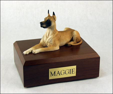 dog sculpture on wood cremation box