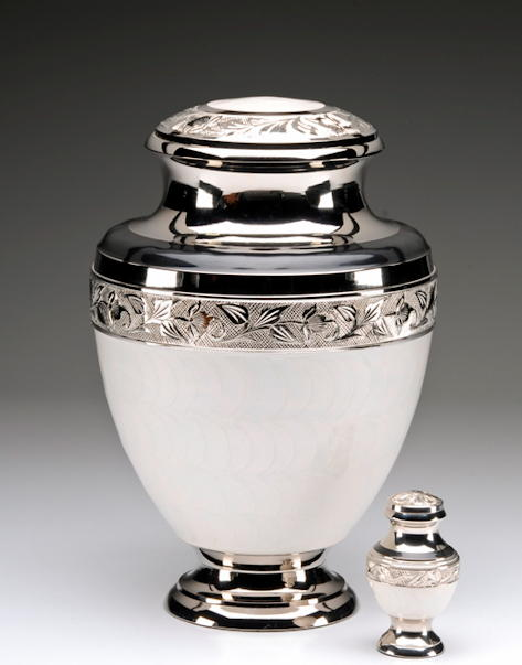 silver and white cremation urn