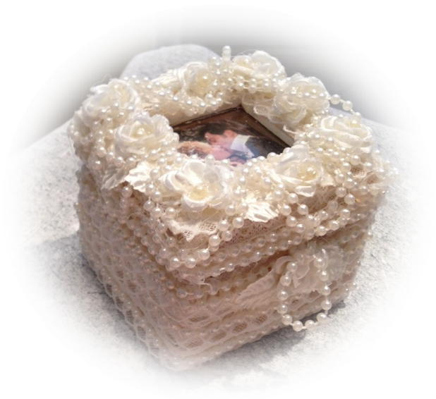 hand made wedding ring box  Is upholstered in an off white lace with pearls and roses.