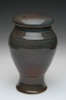 brown and green ceramic urn