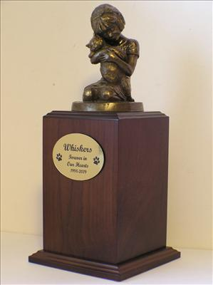 Walnut urn with Little girl bronze statue holding cat
