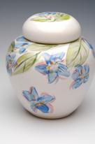 small ceramic urn with painted flowers