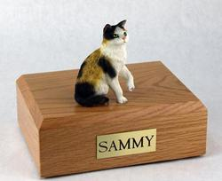 Cat sculpture on wood cremation box