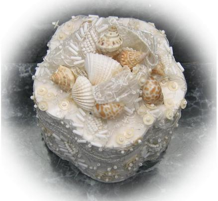top of lace and sea shell wedding ring box