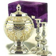silver and gold leaf cremation urn set with candles