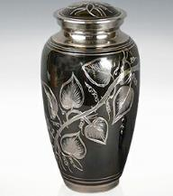 silver leaves on pewter urn
