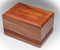 carved rosewood cremation urn