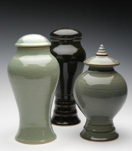 Custom Ceramic urns with a pedistal