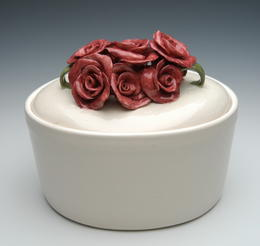 White ceramic urn with ceramic roses