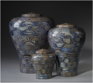 blue stained exotic wood urns